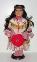 Porcelánový Indián ve stylových šatech (0420231)