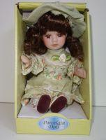 Porcelánová panenka  Nina - 22 cm